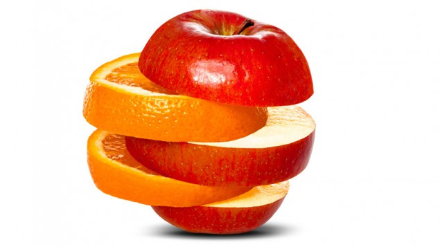 alternating slices of an orange and a red apple stacked on top of each other