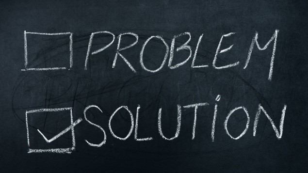 a chalk board with the word 'PROBLEM written in capital letters, with an empty box drawn to the left of it, and the word 'SOLUTION' written in capital letters below 'PROBLEM' and a box marked with a check mark drawn to the left of 'SOLUTION'