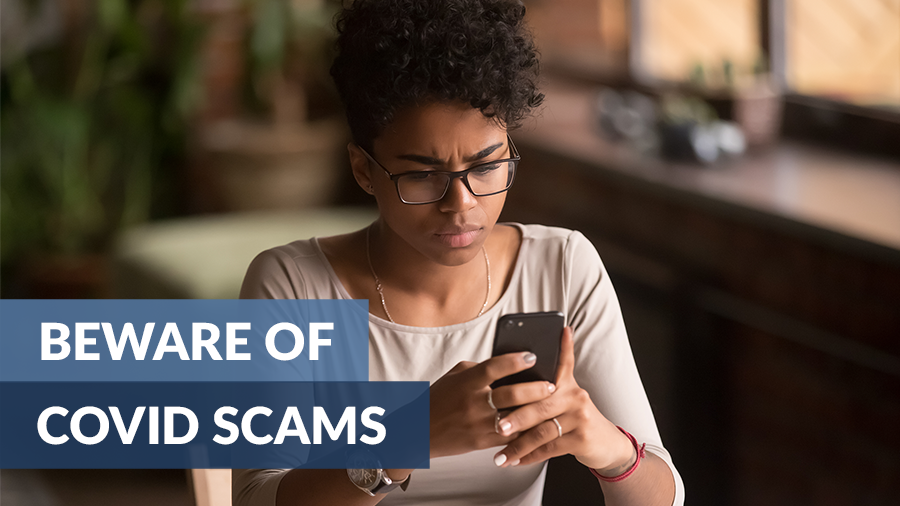 "young African American woman looking at cellphone with a concerned expression, and an overlay with the title of the article ""beware of covid scams"""